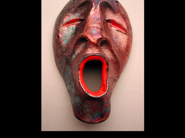 The mask shows the metallic effect produced by raku glazing. The singing spirit, a common motif in Charette's work, represents a Yup'ik view of the life cycle: as mortals rejoice at a new birth, the spirit world mourns the loss of a friend; when earthly life ends and that spirit rejoins its friends, spirits rejoice as mortals grieve.