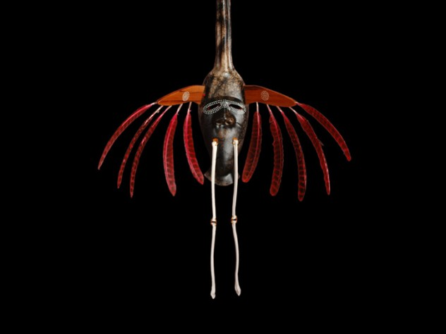 "The crane is a meaningful animal in Yup'ik lore and for Charette personally (see first image in this slide show). This four-foot-tall mask, from an Oregon art gallery, features a full crane face and head on top, and a human-like face on the animal's body to represent its <em>yua</em>. This mask, from Charette's <em>Transformation</em> series, is made of horsehair-fired clay, with porcelain ""bone"" legs and wild-turkey feathers in place of the raptor features used in Yup'ik masks of old."