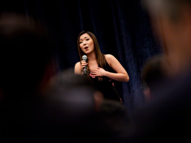 """Wenqian (""""Wendy"""") Wang '10, who interned in Beijing last summer, closes the March 18 banquet with a rousing version of <i>""""Wo ai ni Zhongguo""""</i> (""""I Love You, China"""")."""