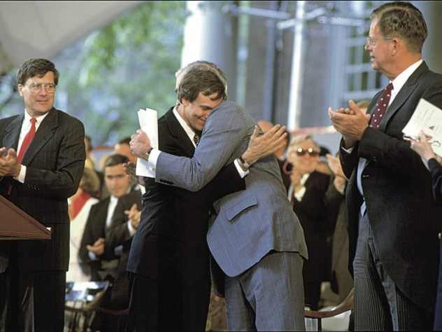After delivering the Commencement afternoon address, retiring President Bok is hugged by president-elect Neil Rudenstine (1991).