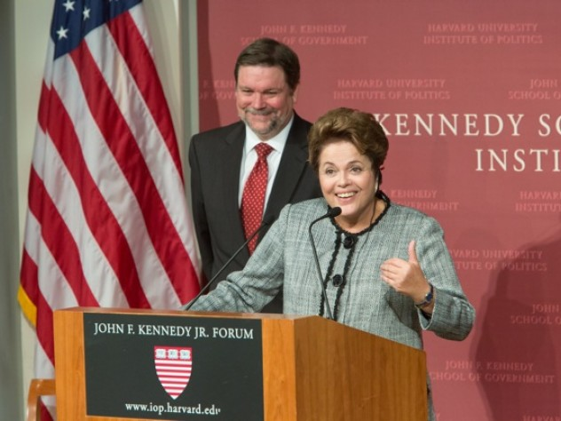 Dilma Rousseff speaks at Harvard Kennedy School. In the background is the school's dean, David Ellwood.