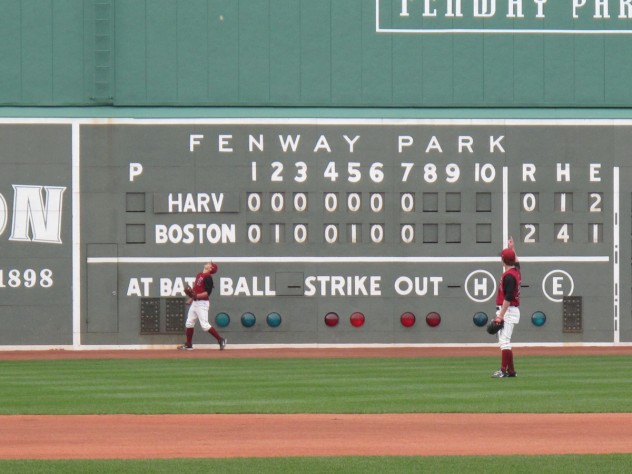 The scoreboard shows the line score of Fenway's first game, on April 9, 1912.