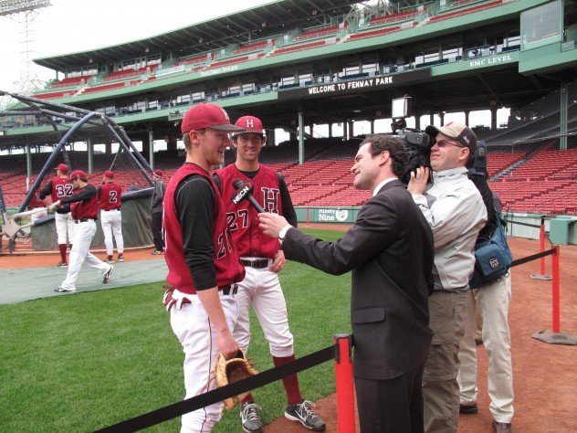 Harvard players are interviewed by a local news station.