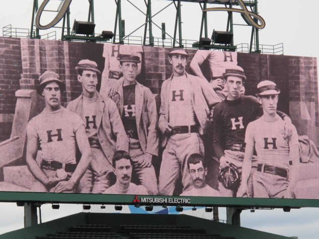 The JunboTron showed Harvard baseball photographs from years past.