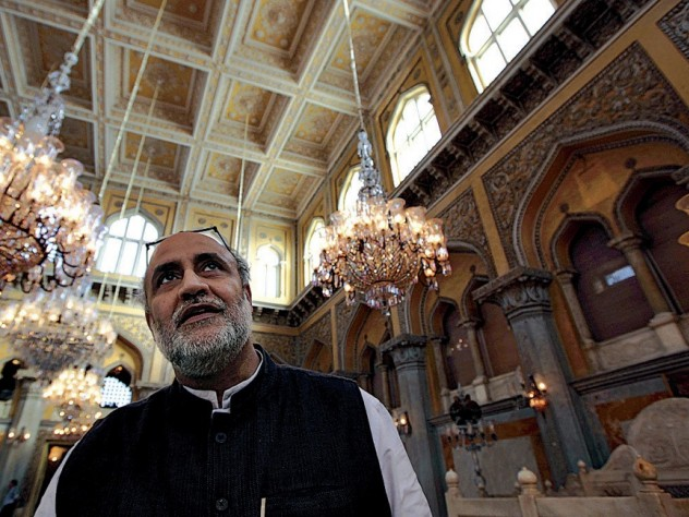 Rahul Mehrotra stands in the <i>darbar,</i> the ceremonial hall where coronations took place.