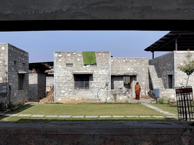 The dwellings are arranged in groups of four, oriented around a central courtyard.