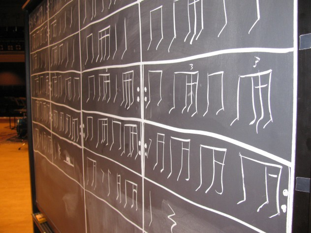 """School of THUD"" also involved rhythms tapped with chalk on a chalkboard. The musicians draw up the score as they play, and play the rhythms forward and backward."