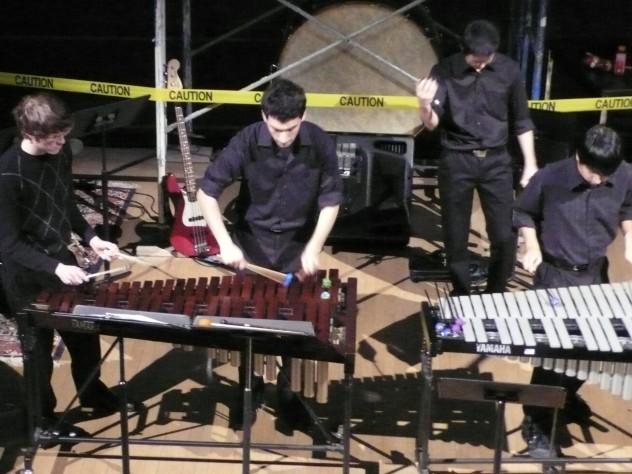 Matthew Watson '15, Noam Hassenfeld '12, Gene Yoo '12, and Jon Gonzales '13 perform at the fall concert.