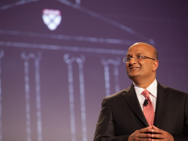 HBS dean Nitin Nohria during his campaign address April 25; a sketch of the iconic Baker Library, with the HBS crest, is projected behind him.