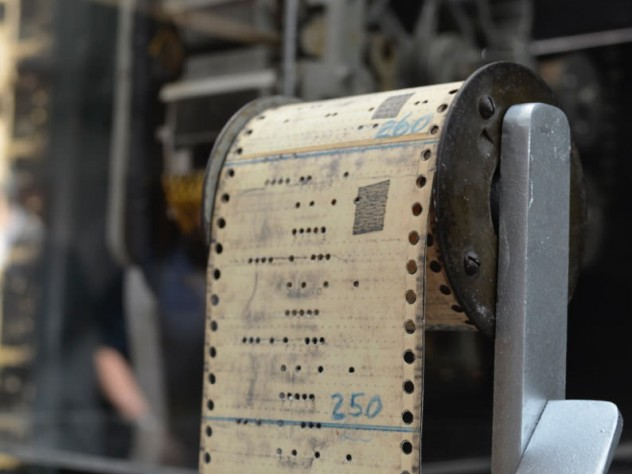The Mark I display includes early punch cards.