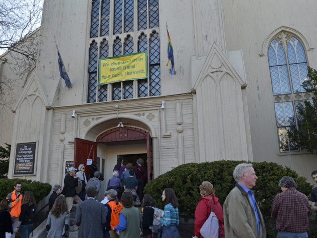 Attendees line up outside the First Parish in Cambridge for Sunday's launch event.