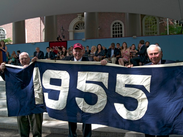 "Members of the Class of 1955 display a banner in their ""class color,"" blue. The Class of 2012 are reviving the ""class color"" tradition, and their color is also blue."
