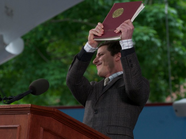 "Andy Samberg holds up ""the collected works of William Yates."""