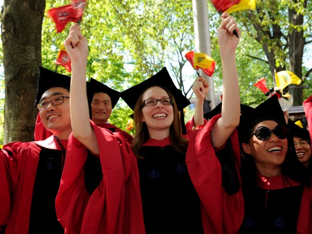 Having just received their degrees, newly minted Harvard Ph.D.s, in their distinctive doctoral gowns, celebrate the culmination of years of study.