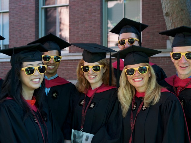 "Ready for anything, Harvard Business School M.B.A.s-to-be fend off the sun in their matching ""HBS Section J 2012"" shades."