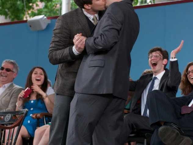 """Andy Samberg kisses Matt DaSilva '12, one of the students who introduced him, onstage as they slow-dance to Adele's """"Someone Like You."""""""