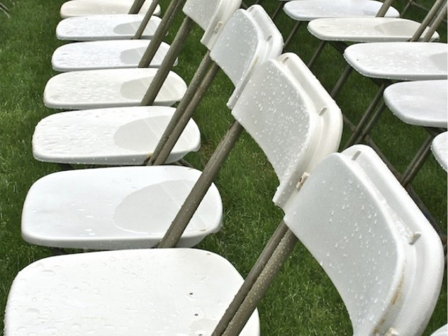 Wet chairs in Harvard Yard Tuesday morning. Rain is forecast for Tuesday, thunderstorms for Wednesday, and sun on Thursday.