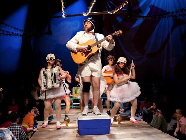 Emily Casey, Sean Pfautsch, Matt Kahler, Ryan Bourque, and Dana Omar. Kahaler, standing on the cooler, plays the Major General.