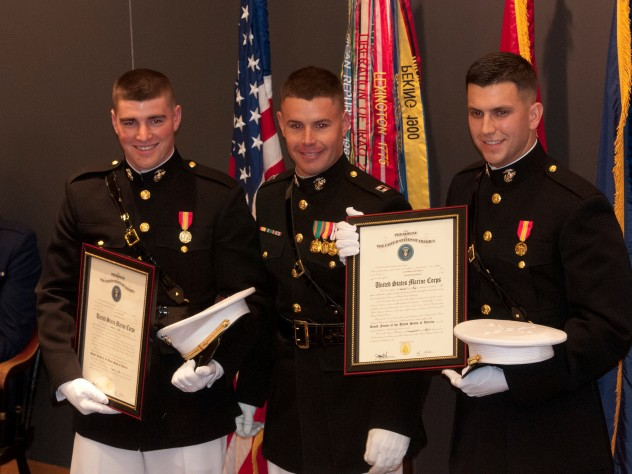 Newly commissioned U.S. Marine officers Brian Furey and Gavin Pascarella (left and right) after taking the oath of office, which was administered by Captain Bryan Warner