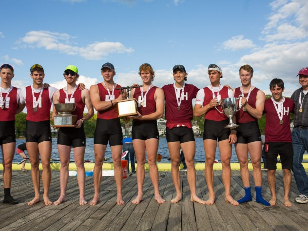 The varsity eight, wearing their gold medals on the dock