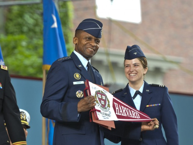 The force is with the U.S. Air Force as General McDew receives a Harvard banner from Second Lieutenant Madison Coveno.