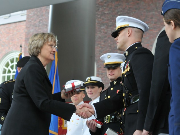 President Faust congratulates the officer candidates. She gave each of them a copy of <i>The Sleepwalkers: How Europe Went to War in 1914.</i>