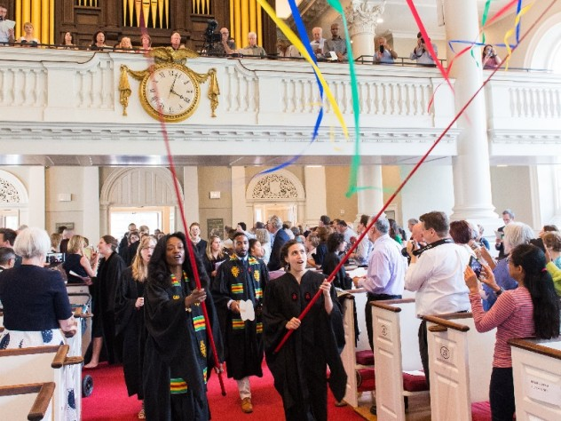 Graduating students carry streamers into Memorial Church.
