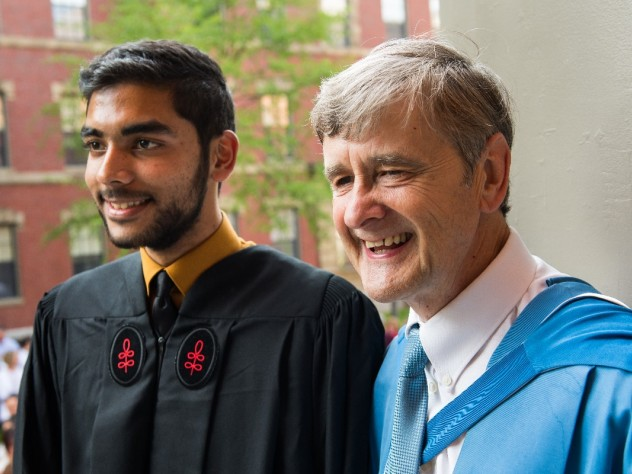 Dean David N. Hempton and a graduating student
