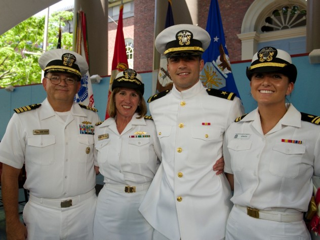 Navy ensign Adam Gracia's sister, Alexandra (at right), administered his oath of office, and his parents pinned on his insignia.