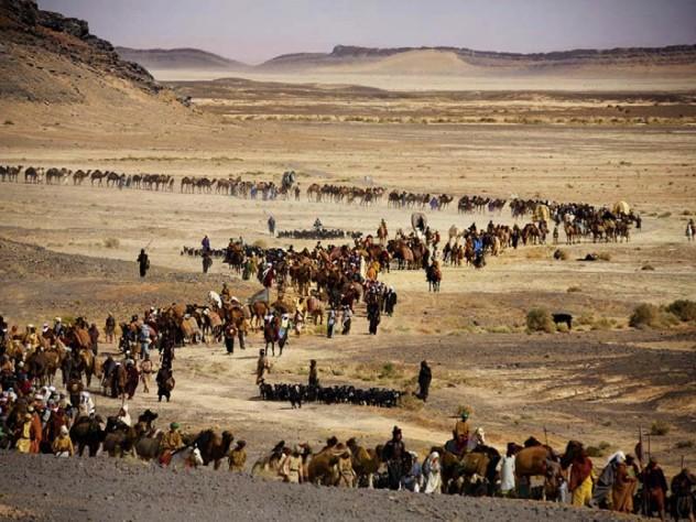 An astonishingly long desert caravan (above) is part of <em>Journey to Mecca.</em>