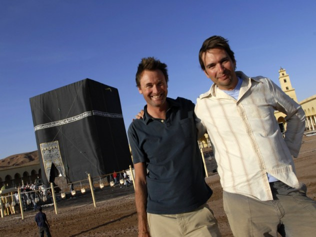 Cosmic Picture's founders Taran Davies '93 (right) and Dominic Cunningham-Reid in Morocco. The structure behind them is a replica of the Ka'ba, the most sacred site in Islam, built for production purposes.