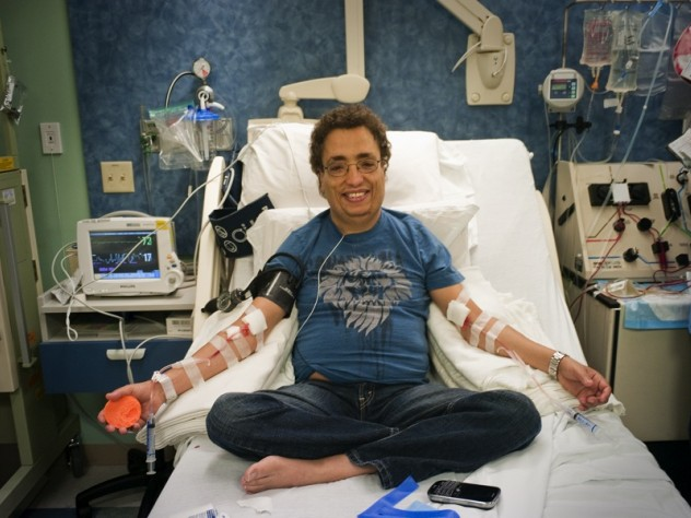 All in a day's treatment: Khaled, seen in these photographs with hemapheresis practitioner Beverly Gedutis, R.N., and author David Nathan, spent May 8 at Children's Hospital Boston, where for decades he has been transfused with red blood cells every three weeks. The bottles he carries below contain the iron chelator deferisirox.