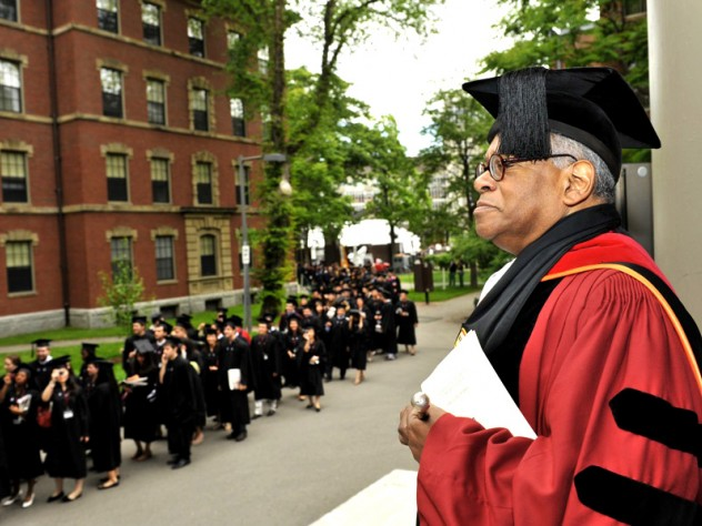 Shepherd and flock: at Memorial Church, the Reverend Peter J. Gomes awaits arrivals for the senior class chapel service.