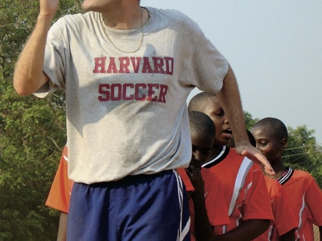 Nick Gates '91, who founded Coaches Across Continents, works with coaches (above) and youths (at right) in Tanzania in 2009.