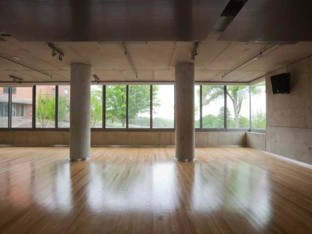 Windows let in light and rural views during yoga classes