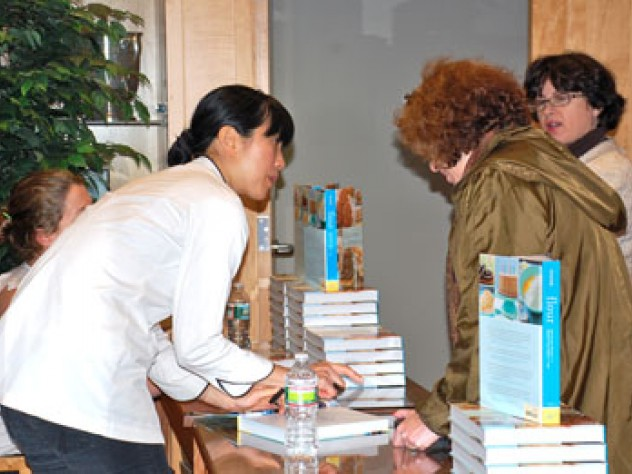 Joanne Chang signs books for guests.