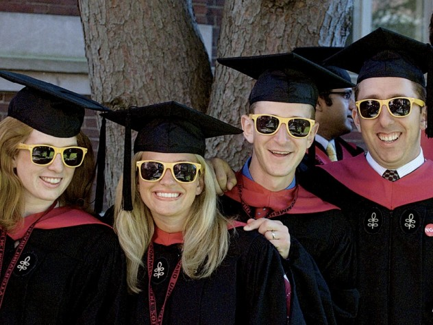 """Loyal to their M.B.A. cohort: Carolyn Daly, Stephanie Bartz, Robert Klaber, and Randy Shayler II showed up in matching """"HBS Section J 2012"""" shades."""