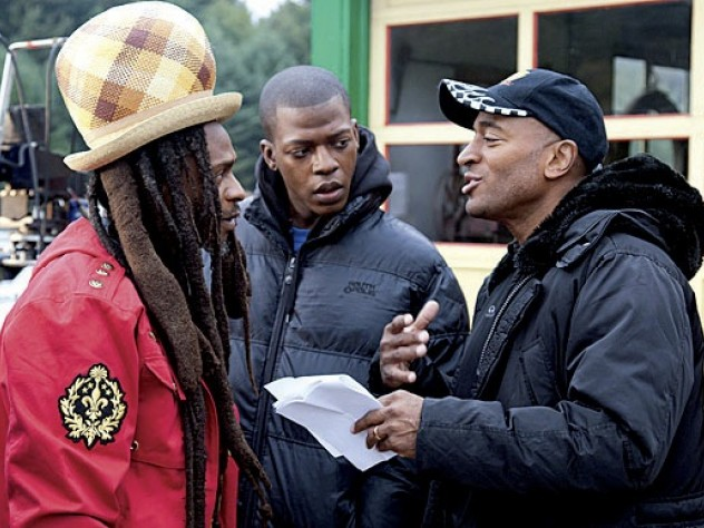 Khan advising Rastafarian musician David Hinds and Sanders