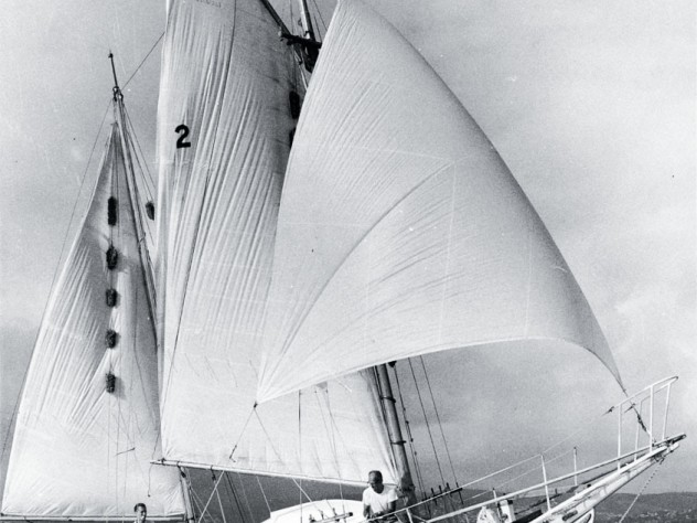 The 30-foot <em>Golden Rule</em> under sail, with James Peck &rsquo;36 and Willoughby visible