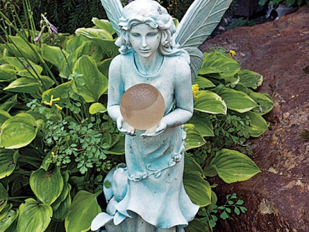 A statue of Titania holds a solar-powered orb.