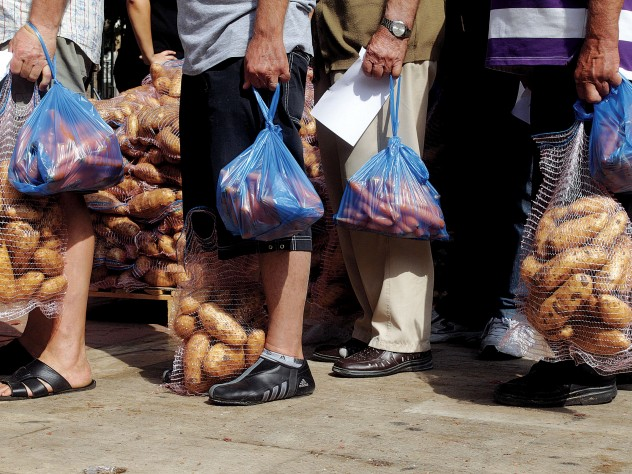 Hunger stalks southern Europe: A nationalist political party distributes food in Athens, September 14, 2012.