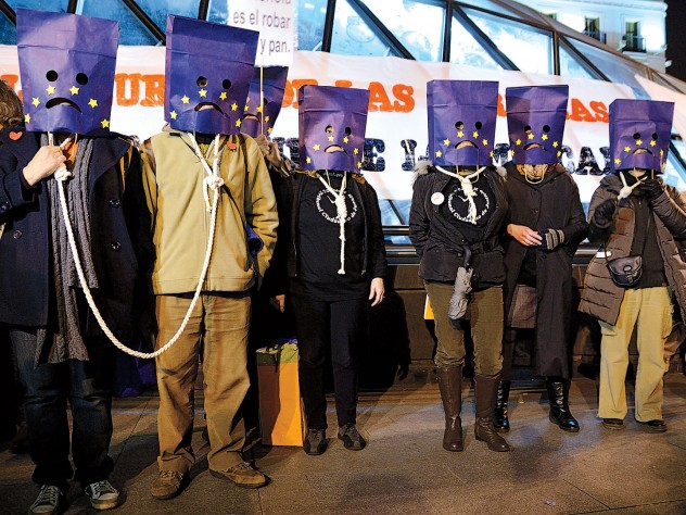 Political passions: Madrid protesters against austerity wear nooses and bag their heads with a European Union flag motif, March 16, 2013.