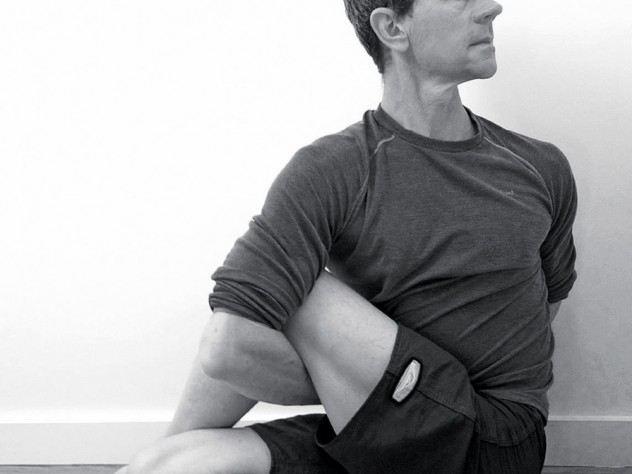 "Dan Boyne demonstrates the <i>ardha matsyendrasana</i> (""half lord of the fishes"") yoga posture."