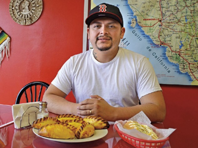 """Que Padre owner Victor Duran (top) serves Mexican and Bolivian specialties: beef <i>saltenas</i> and the """"Sonora hotdog""""—with bacon, beans, and jalapeño sauce."""