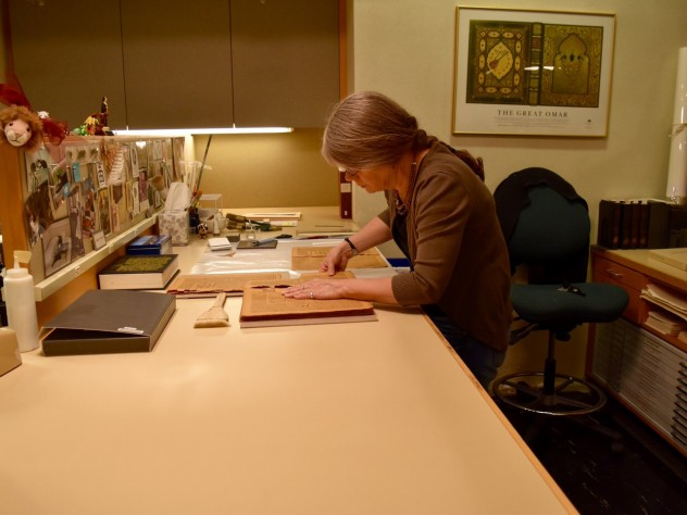 A book conservation specialist works on the preservation of rare books in Widener's Conservation Lab, located in its basement.
