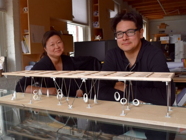 Eric Höweler and Meejin Yoon, with a model of the swings they designed