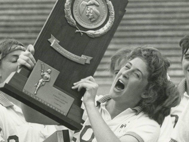Julie Smail '90 celebrates the Crimson's winning of the NCAA national championship.