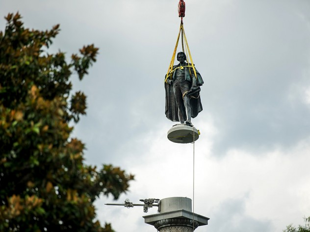 Photograph of John C. Calhoun statue in Charleston in midair being lifted up by a crane