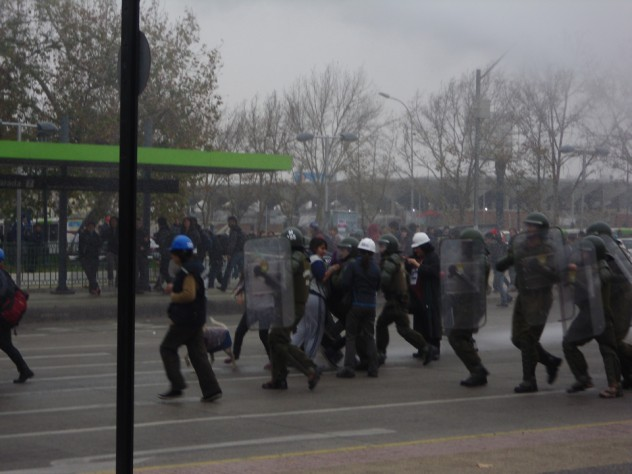 Chilean policemen detain students at a march in Santiago, Chile, in May 2012.