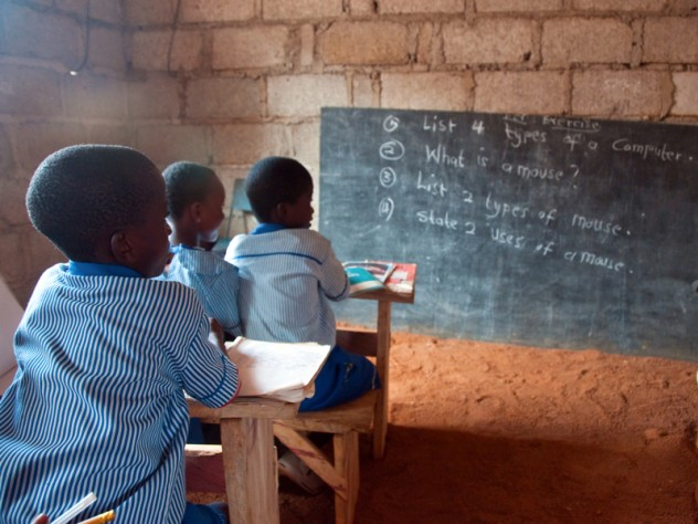 Students learn about computer skills in a classroom at Christ is the Answer Preparatory School in Adansi-Dompoase, outside Kumasi. According to school proprietor Anthony Kwasi Nyarku, private schools such as his are superior to Ghanaian public schools because the government-run schools are often under-supervised and a strong union protects the sometimes negligent teachers.